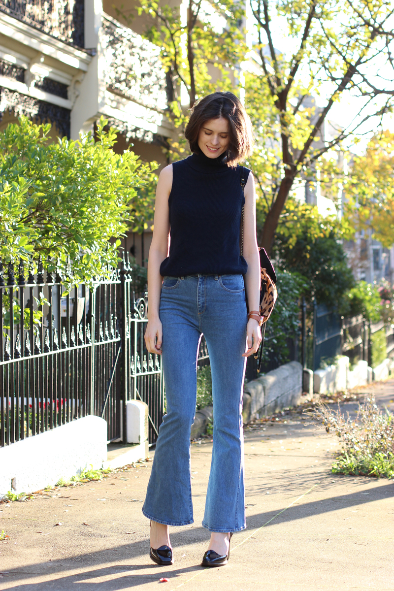 FASHION-AND-SHOPPING-BLOG-Chloe-CHill-in-Lulu-and-Rose-navy-turtleneck-top,-wrangler-flared-jeans-from-Glue-Store,-Triwa-rose-gold-and-tan-watch-and-bottega-venetta-platform-heels
