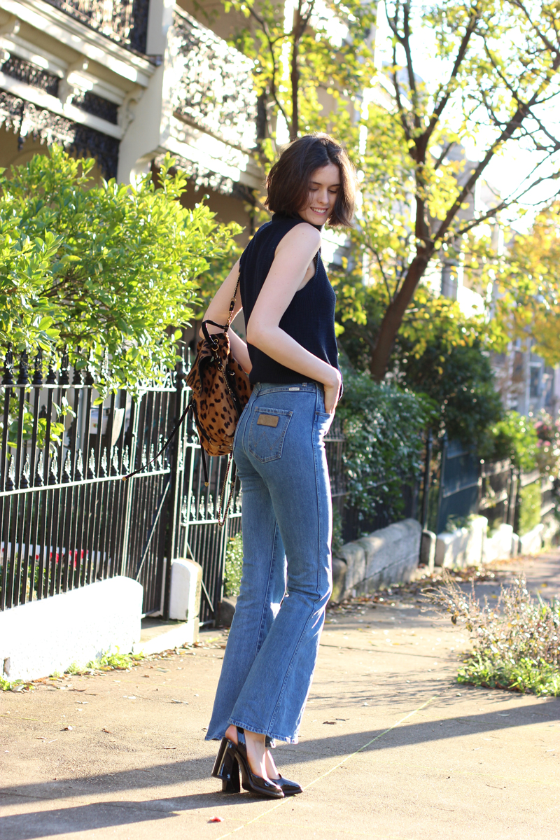 FASHION-AND-SHOPPING-BLOG-Chloe-CHill-wearing-Lulu-and-Rose-navy-turtleneck-top,-wrangler-flared-jeans-from-Glue-Store,-Triwa-rose-gold-and-tan-watch-and-bottega-venetta-platform-heels