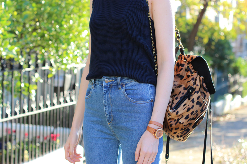 FASHION-AND-SHOPPING-BLOG-_-Chloe-Hill-wearing-Lulu-and-Rose-navy-turtleneck-top,-jerome-dreyfuss-leopard-backpack-and-wrangler-flared-jeans-from-Glue-Store
