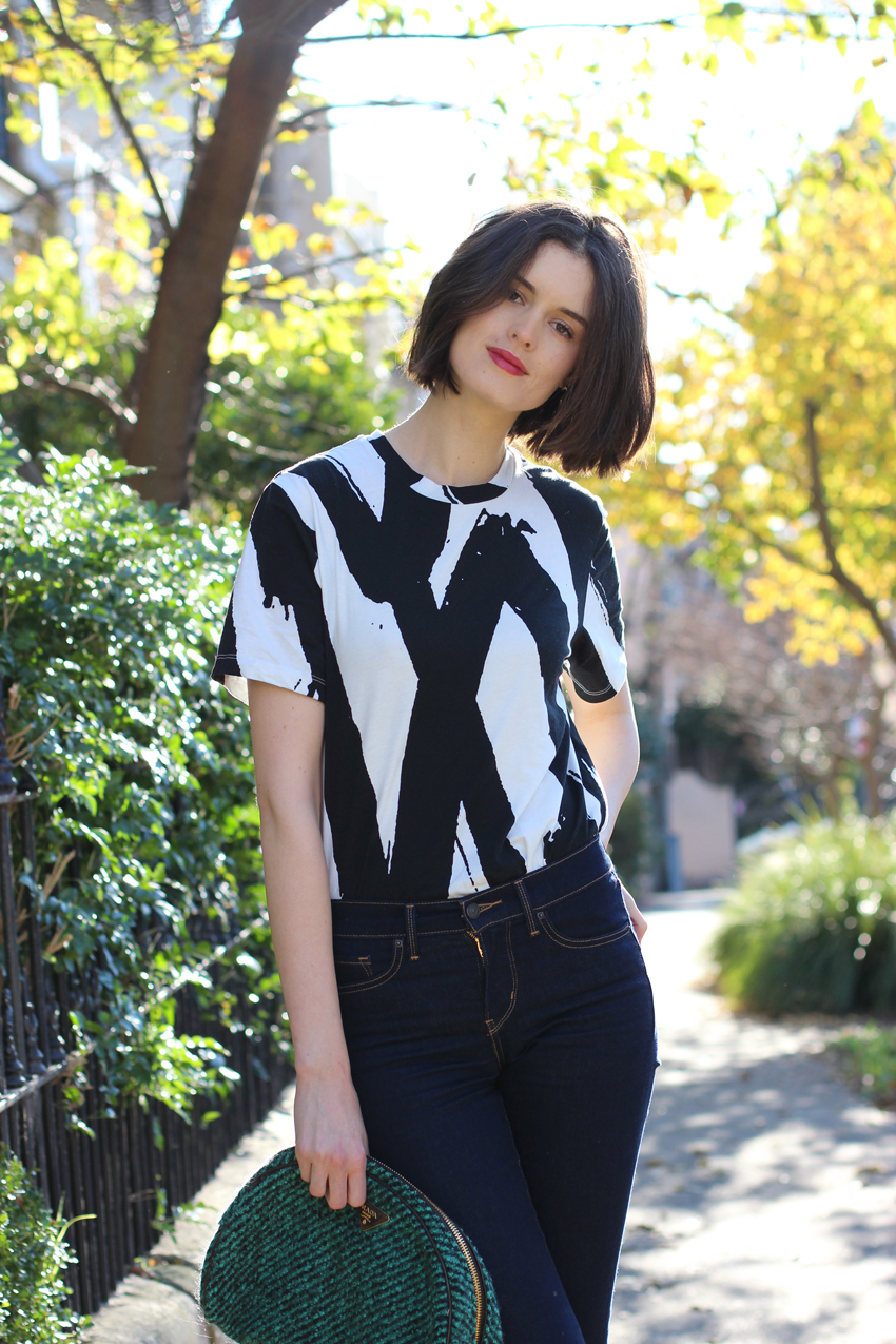 AUSTRALIAN-FASHION-BLOG-Chloe-Hill-Wearing-Cocurata-black-and-white-paint-print-tshirt-and-levis-shaping-bootcut-denim-jeans-on-the-streets-of-sydney