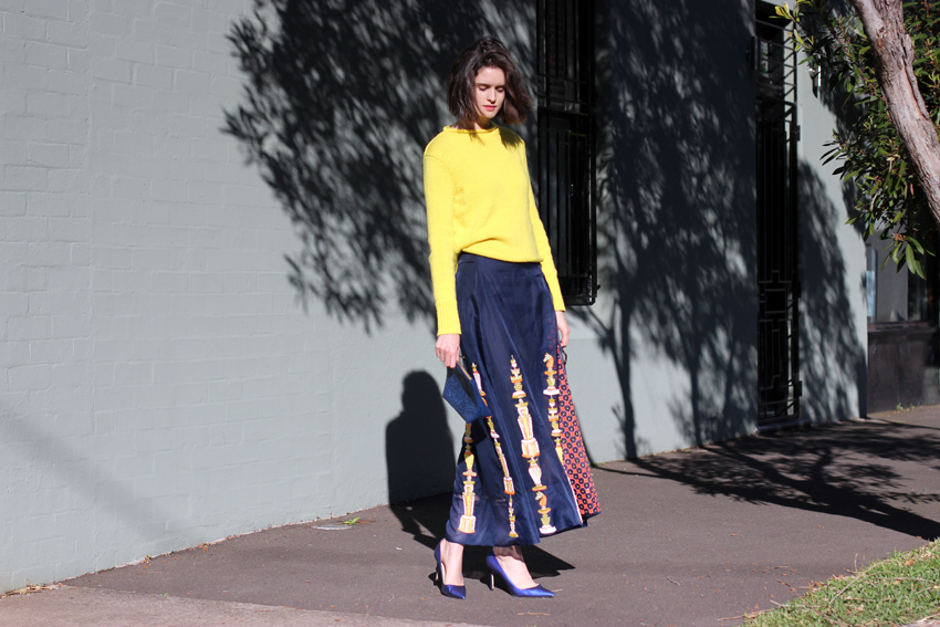 Chloe-C-Hill-in-Cos-yellow-jumper,-after-the-apple-clutch,-Easton-Pearson-beaded-full-legnth-skirt-and-manolo-Blahnik-blue-heels