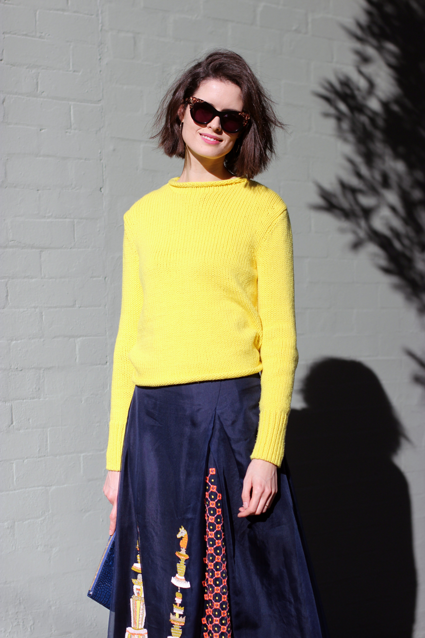 Chloe-Hill-in-Cos-yellow-jumper,-Easton-Pearson-beaded-full-legnth-skirt-and-manolo-Blahnik-blue-heels