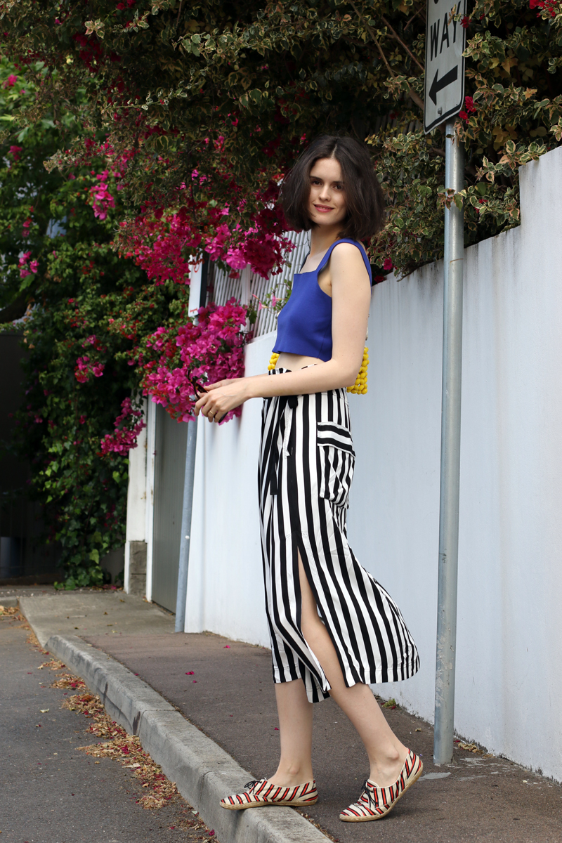 Chloe Hill Wearing Marni blue crop top and beaded bag, Lee Mathews stripe wrap skirt and Tabitha Simmons striped shoes in Paddington