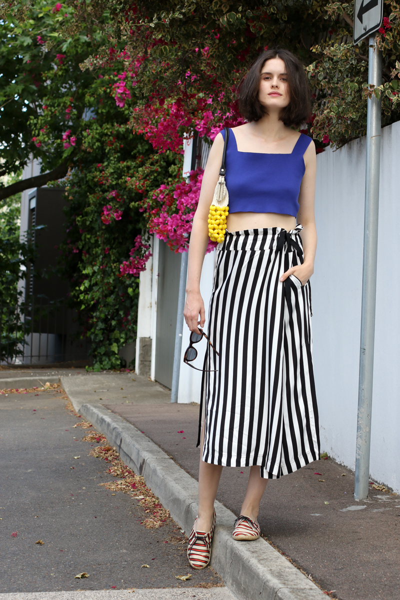 Chloe Hill Wearing Marni blue crop top and beaded bag, Lee Mathews stripe wrap skirt and Tabitha Simmons striped shoes