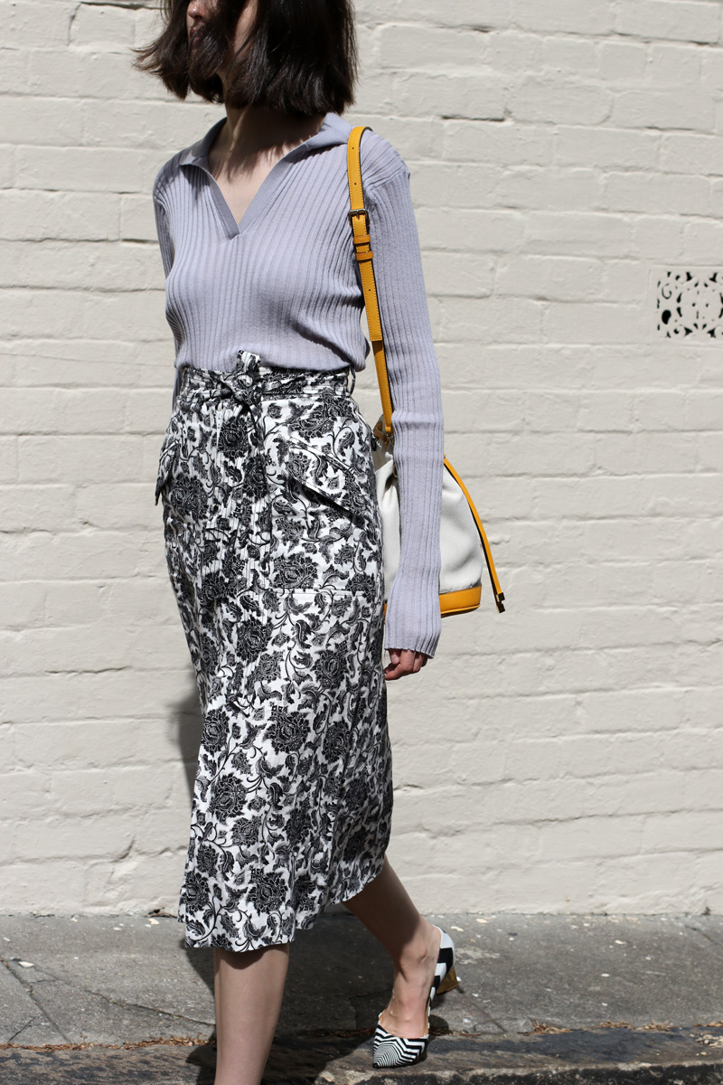 Chloe Hill Wearing Wynn Hamlyn grey merino polo top, Zimmermann floral skirt, Oroton mustard bucket bag and nicholas kirkwood shoes on the streets of Sydney