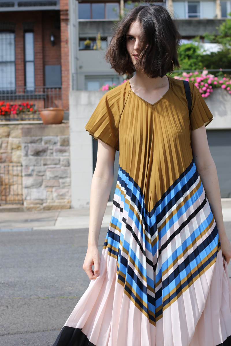 Chloe-Hill-Wearing-Zimmermann-blue-and-brown-striped-pleated-shift-dress