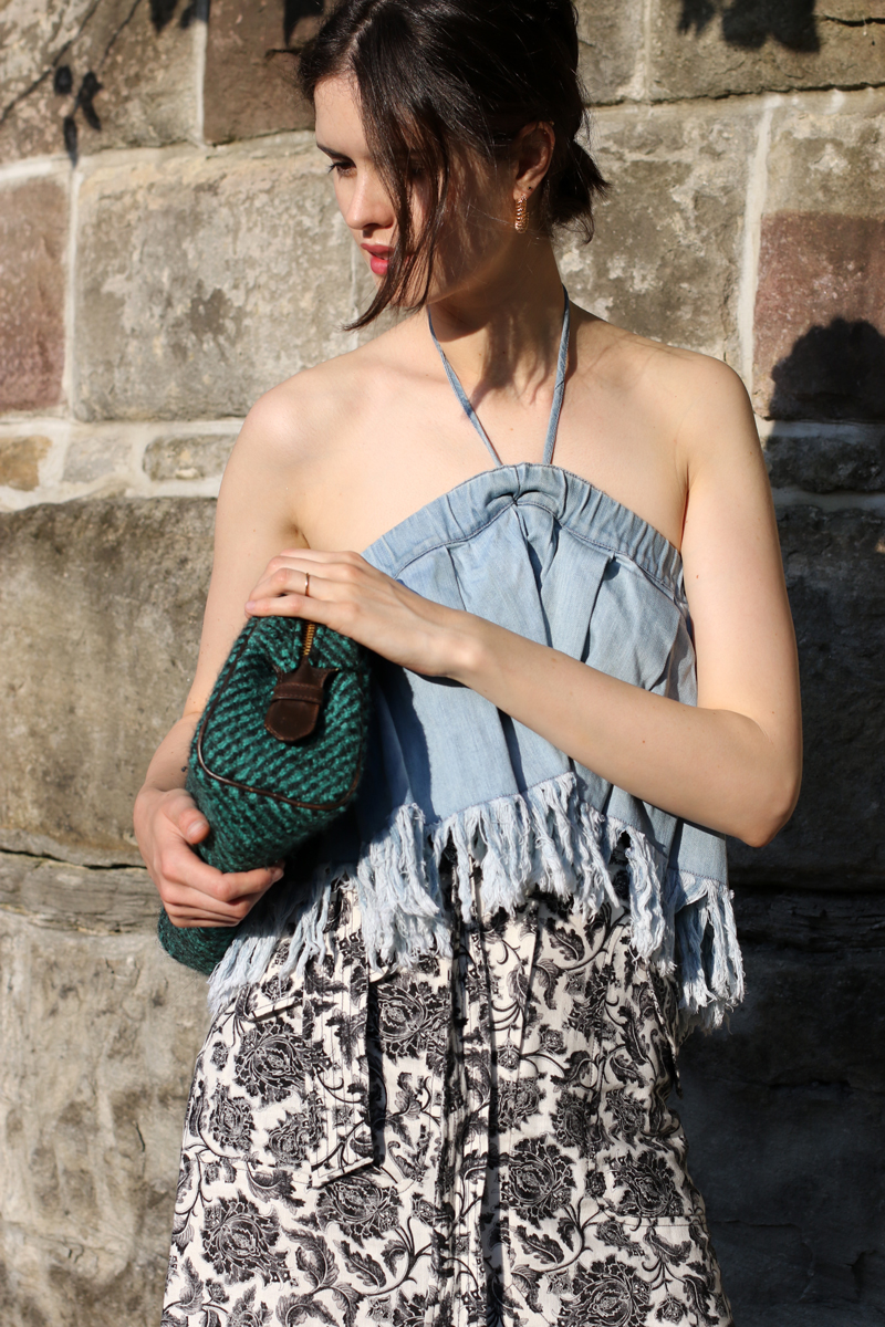 Chloe Hill Wearing Zimmermann floral midi skirt, prada clutch and Vale denim frayed jean top