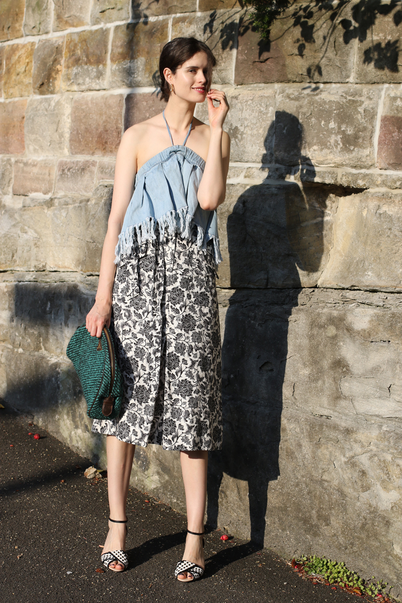 Chloe Hill Wearing Zimmermann floral midi skirt, prada clutch sportmax leather sandals and Vale denim frayed jean top on the streets of sydney