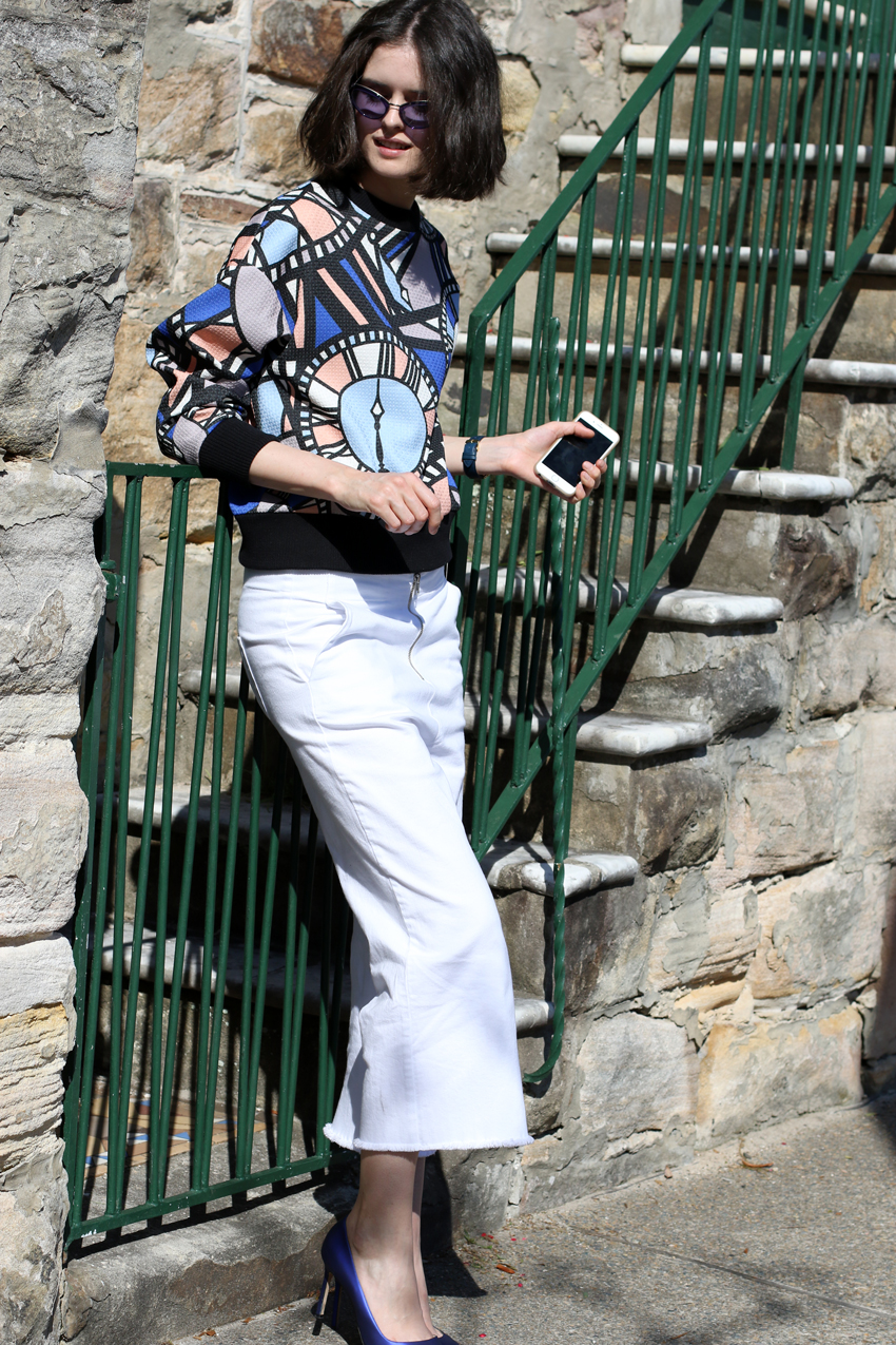 Chloe-Hill-in-Karen-walker-watch-print-sweatshirt,-Valen-denim-white-fray-culottes,-larsson-and-jennings-watch,-manolo-blahnik-shoes