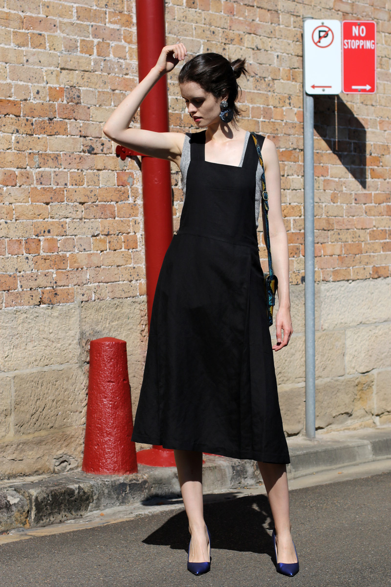 Chloe Hill Wearing Bul pinafore dress, iro paris grey tank top, vintage sequin earrings and manolo blahniks on the streets of sydney