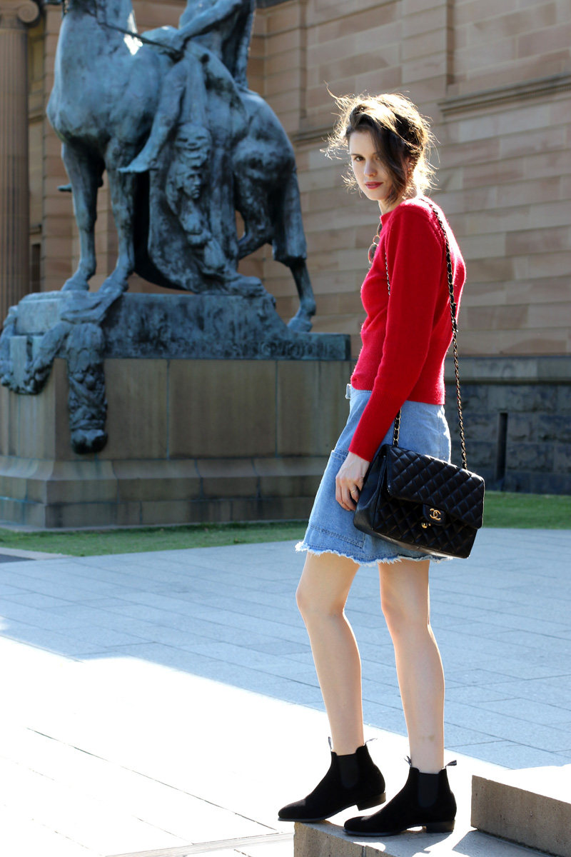 Chloe Hill Wearing Lemair x Uniqlo fluffy jumper, karen walker denim skirt, RM Williams Adelaide suede boots an Chanel quilted shoulder bag outside the Art Gallery of NSW, Sydney