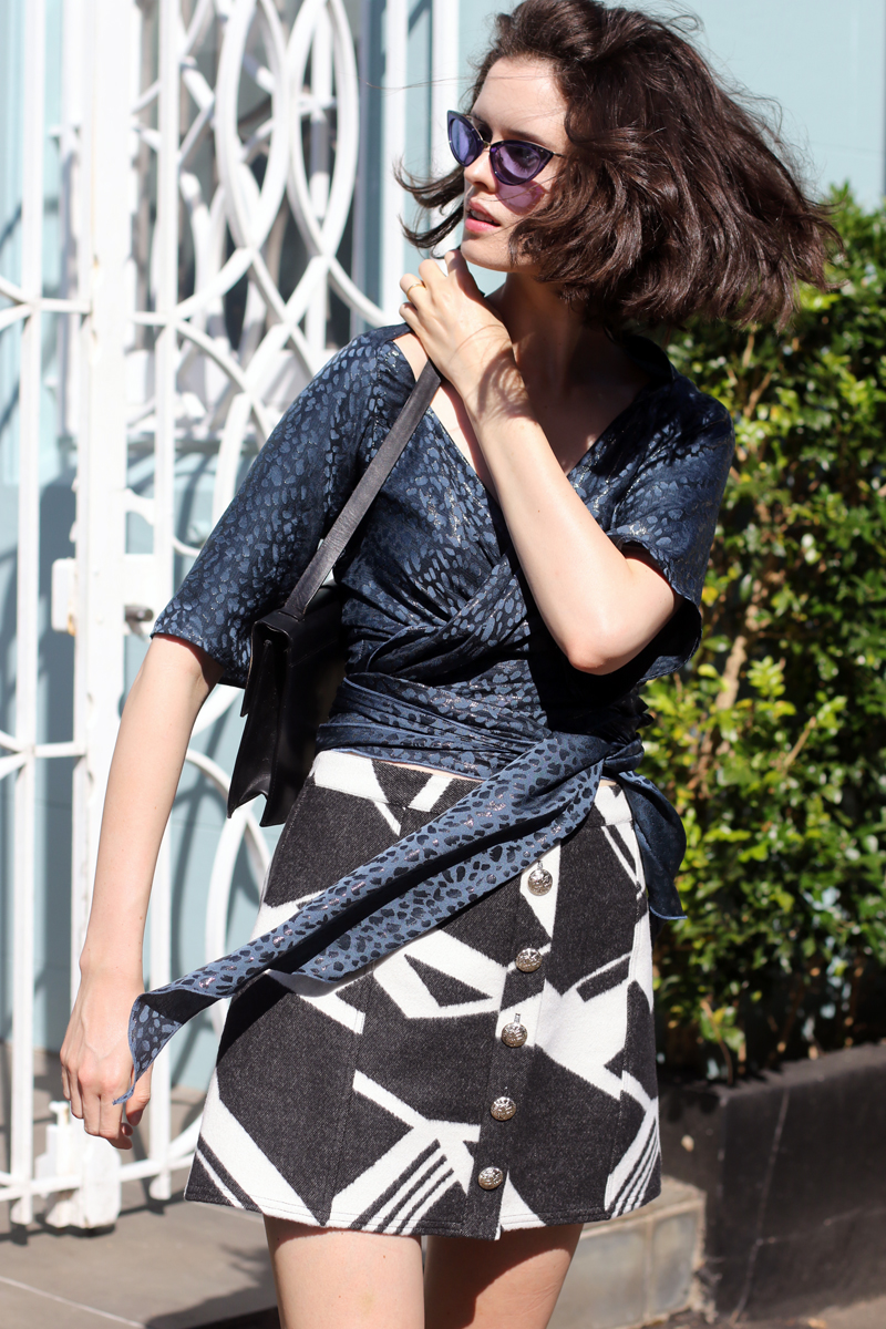 Chloe Hill wearing a Eugenie teal wrap top, River island printed skirt, Tom Ford Sunglasses and a Vintage Gucci bag on the Streets of Sydney
