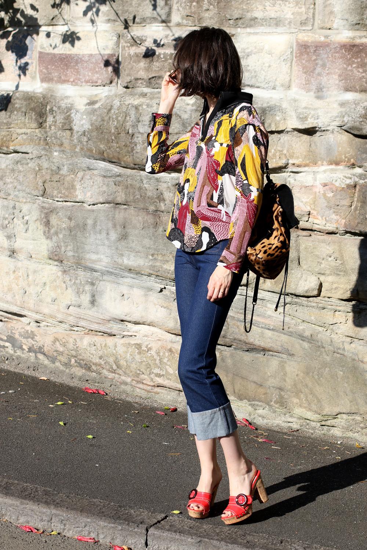 Chloe Hill Wearing Karen walker long sleeve printed zip top, Karen Walker cuffed jeans, Prada red patent cork heels and Jerome Dreyfuss leopard backpack