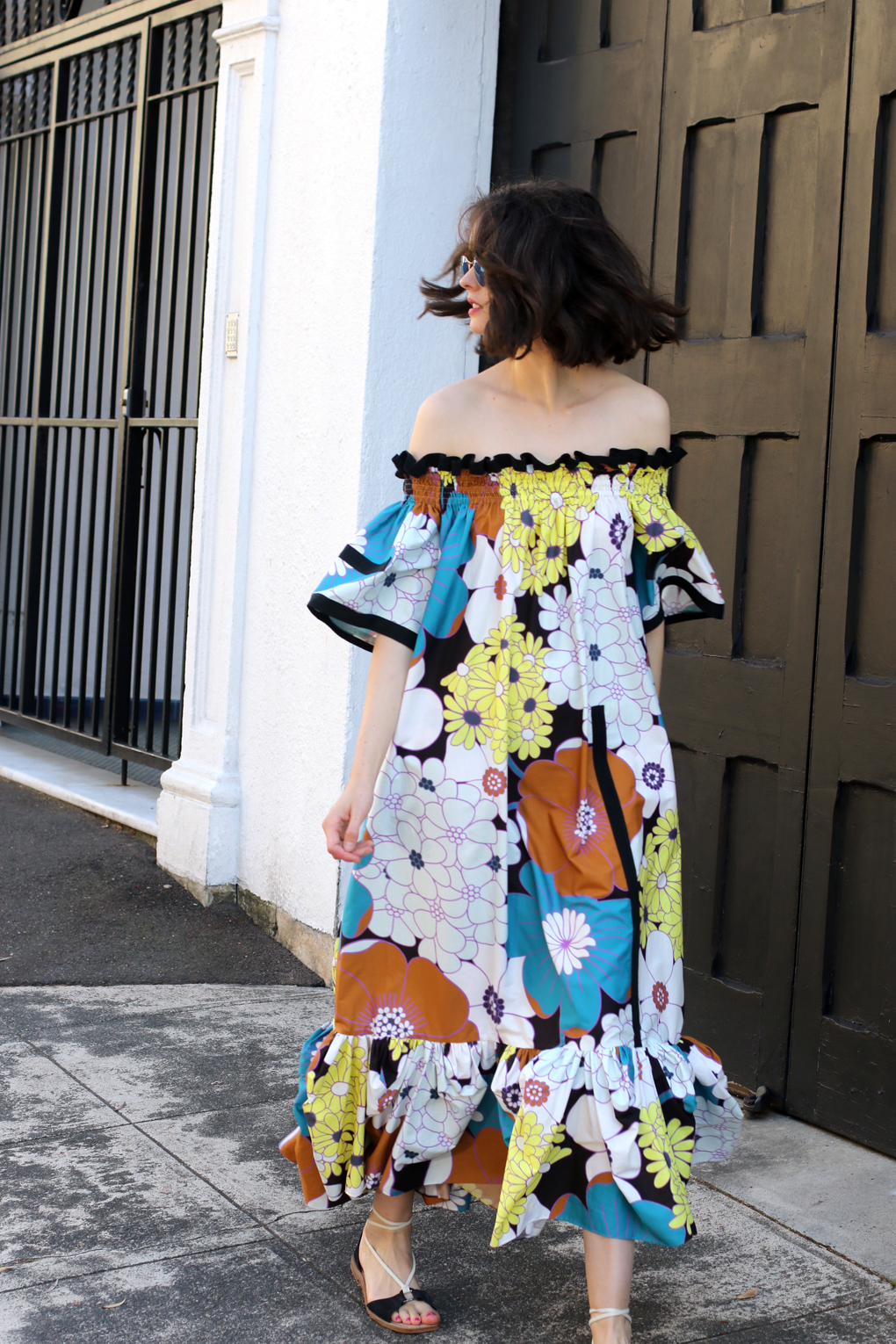 Chloe Hill wearing Easton Pearson off the shoulder floral maxi dress and rayban round reflective sunglasses on the streest os Elizabeth Bay, Sydney