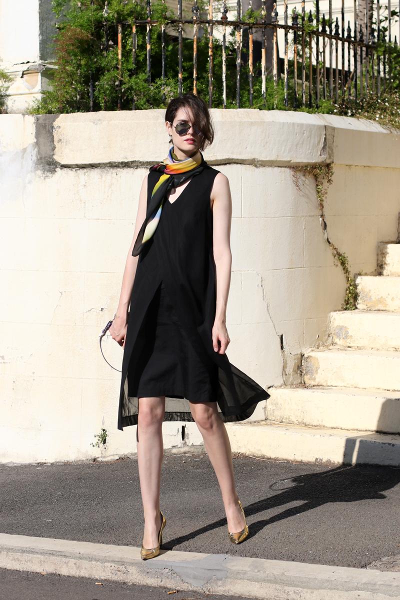 Chloe Hill wearing Gary Bigeni layered black dress, Deadly ponies x len lye rainbow scarf, reflective rayban aviators and gold manolo blahniks