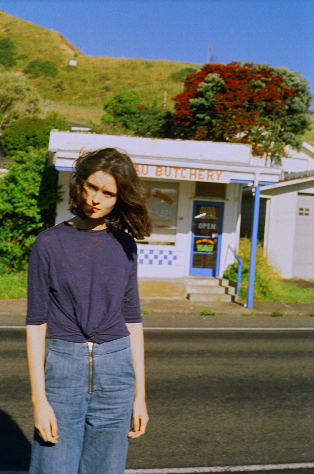 CHLOE CHILL TRAVEL Wearing Thursday Sunday top and Vale denim jeans outside Mokau Butcher