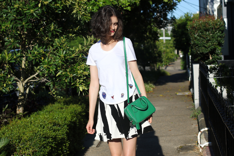 Chloe Hill Wearing Mira Mikati Tshirt from Shopbop, Cocurata skirt and a Bally green bag on the Streets of Sydney