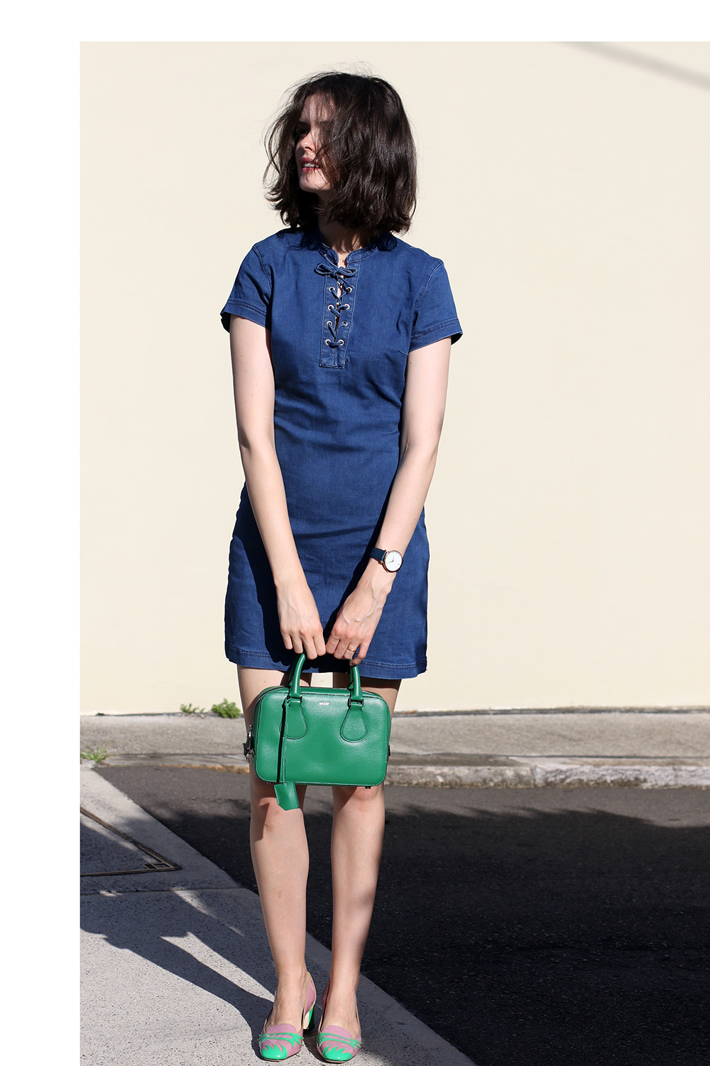 Chloe Hill wearing Misguided lace up denim dress, Bally green mini top handle bag, Bottega Veneta pink and green shoes in Sydney
