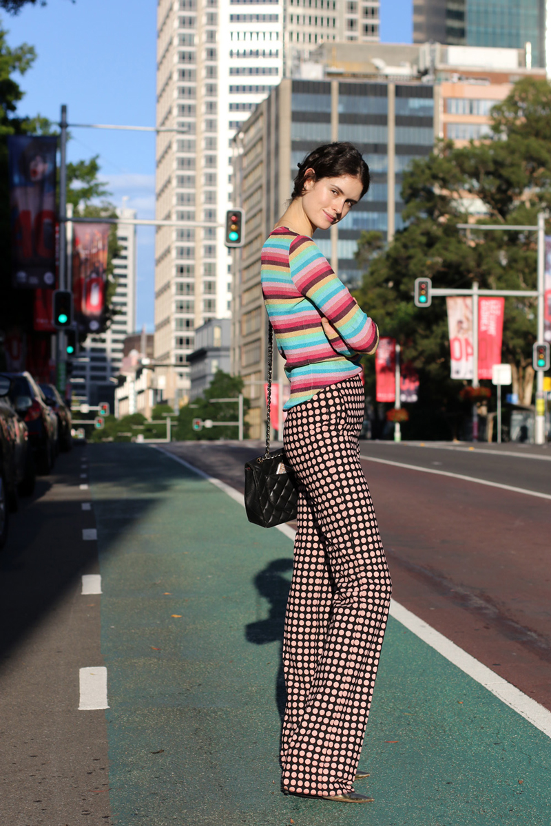 Chloe Hill wearing a Dolce and Gabbana striped cardigan, Bottega Veneta spot print pants and a Chanel quilted shoulder bag on the Streets of Sydney Australia