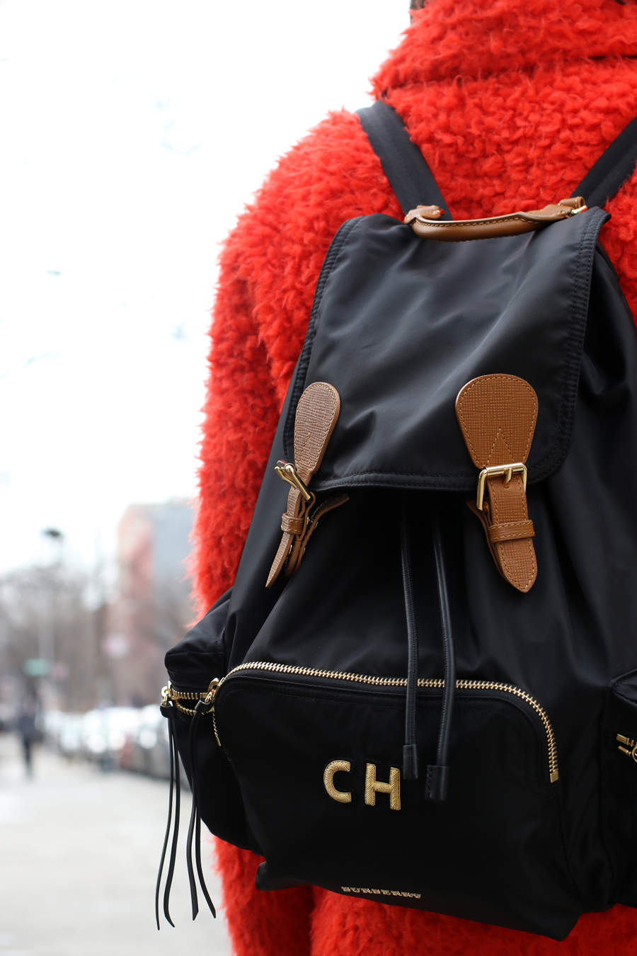 What to wear for New Yorks Winter - Coach furry red coat and Burberry Initial backpack