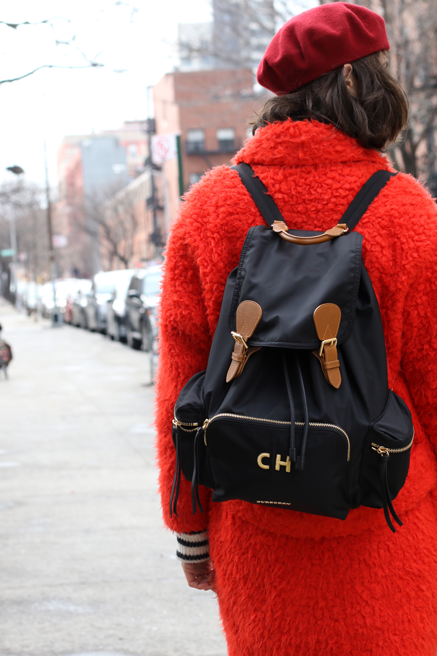 What to wear for New Yorks Winter - Coach furry red coat and Burberry Initial black and gold rucksack