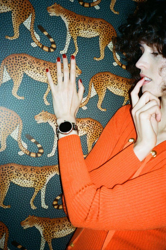 Chloe Hill MK Access watch at the Henrietta hotel in london - Leopard print wallpaper